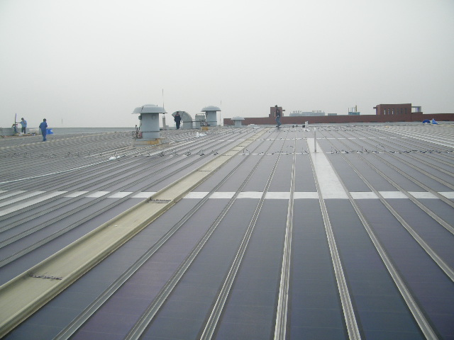 Thin film flexible solar power roofing system for Flexible roofing material